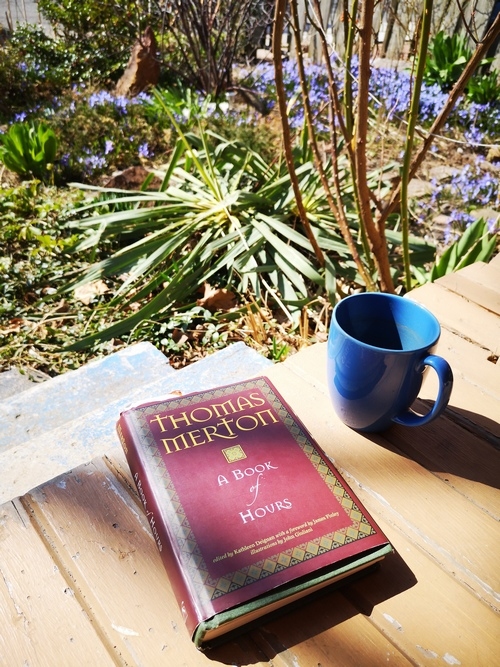 Prayer book and tea cup on the porch (Thomas Merton, A Book of Hours)
