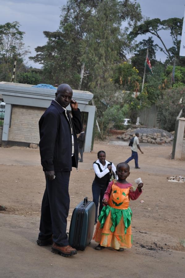 A child in a pumpkin dress in Kibera slum