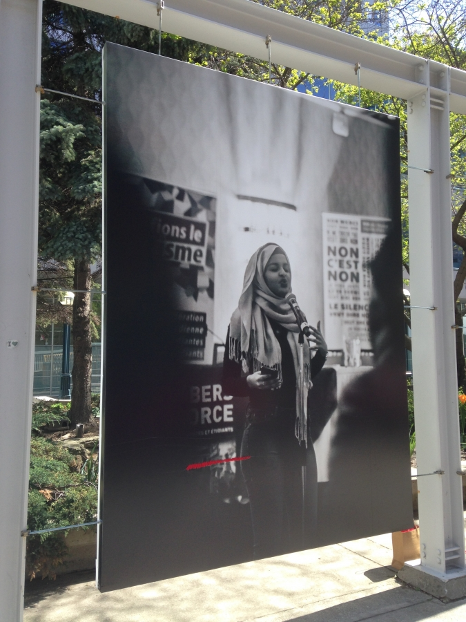 Repaired slashed photo of a Muslim woman