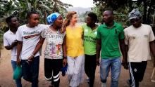 Carole walking arm in arm with members of Light of the World drama troupe, Rwanda