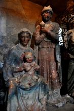 Mary and Joseph holding Jesus (statues)