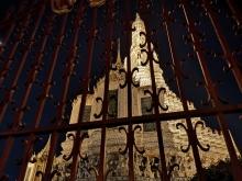 Wat Arun through a gate at night
