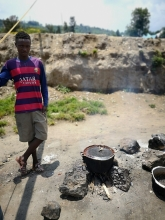 Pascale shows me a cooking fire a fisherman was cooking beans over