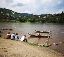 Men overlooking fishing boats on Lake Kivu, Rwanda
