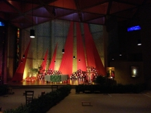 Candles, prayer benches and banners in the church at Taize